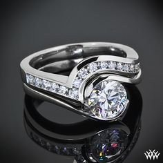 platinum Custom Diamond Wedding Band was made to match the Custom Tension Solitaire Engagement Ring it is seen with.  A CUT ABOVE® Hearts and Arrows Diamond Melee in a beautiful channel set design