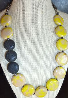 Round lemon yellow and black lava beaded necklace by terrygoddard, $33.00