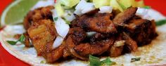 Marinated in a spicy adobo mixture, this tender meat is the base of an…