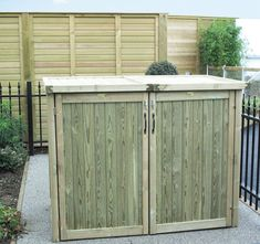 Jacksons Wheelie Bin Store - designed for two wheelie bins, with two front hinged doors and two hinged lids which open upwards to allow access to the bins, whilst they are inside the store Wooden Planters, Wooden Garden, Modern Fence Panels, Bin Store Garden, Jacksons Fencing, Storage Bins, Storage Solutions, Storage Systems, Storage Cabinets