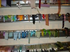 gutters, yes gutters, hung on wall to store ribbons.