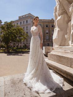 Classic, confident and timeless wedding dress by Elena Novias!