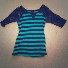 Stripped shirt Navy blue and teal stripped shirt with lace sleeves. Worn a couple time to class. No holes or tears in the lace sleeves. Sleeves go down to the elbows and are not itchy. Rue 21 Tops Blouses