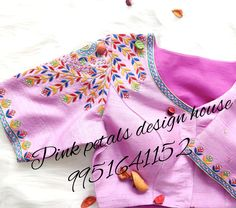 You will definitely go aw.... Lavendered multi color thread embroidery blouse