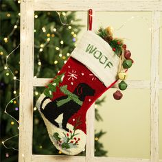 """A cute black dog wearing a green scarf in the snow and a white cuff that reads """"Woof"""" make this the most barktastic stocking for dog lovers. Easily hang this stocking on Christmas trees, hooks or from a mantel with the attached loop. Whimsical Christmas, Christmas Themes, Vintage Christmas, Christmas Crafts, Christmas Decorations, Holiday Decorating, Christmas Ornament, Pet Christmas Stockings, Christmas Stocking Pattern"""