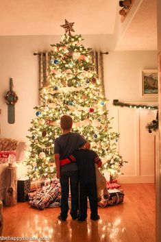 Brothers! What a precious scene in front of the Christmas tree!