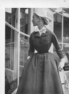 Voluminous skirt creates illusion of impossibly small waist.  Harper's Bazaar, February 1952 by dovima_is_devine_II, via Flickr