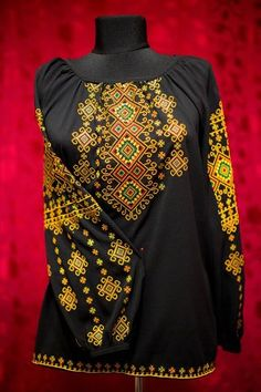 Stunning traditional Ukrainian style embroidered blouse.  Yellow, red, and green embroidery on black.