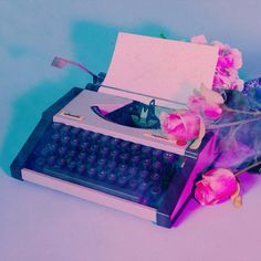 still life photo - via @/the1975 on Twitter { vintage old typewriter throwback artificial flowers rose aesthetic }