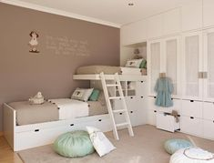 white beds and taupe walls.... I just dont know how anyone would feel with someones feet above their heads when they sleep lol