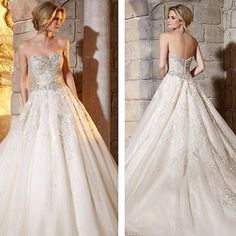 I really like the design of this dress!  Usually I don't like bridal gowns that are excessively big a the bottom.  This one is an exception though I think.