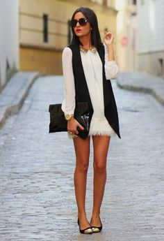 Long black vest over long sleeved dress. Tone down a dressy dress for day with a long vest. | Outfit | Style | Look | Black and White | Sleeveless | Jacket | Blazer |