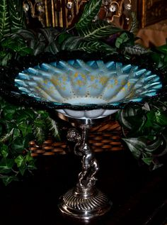 Brides Basket/Centerpiece: Lovely Blue Cased Art Glass Brides Bowl with Quilted Rim and Wonderful Enamel Decor Sitting on Silver Plate Brides Basket Featuring Cherub