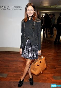 As IF ultimate socialite Olivia Palermo wouldn't have one.   Click for a gallery of Celebs who work a Birkin!