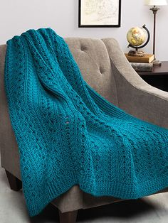 """Different cable patterns give cozy texture to this gorgeous Celtic-inspired throw. Once the cable rows are established, it's easy to continue the repeat patterns. Includes written instructions only. This e-pattern was originally published in the December 2015 issue of Crochet World magazine. Size: 54"""" x 52"""". Made with medium (worsted) weight yarn and a size K/10 1/2/6.5mm hook. Skill Level: Intermediate ~ intermediate skill ~ size; 54"""" X 52"""" ~ it's a beauty!"""