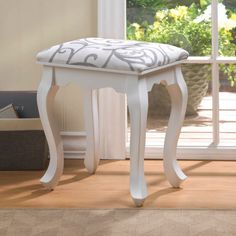 You could easily find the perfect spot for this beautiful foot stool in just about every room of your home! White wood frame features romantic curved legs while