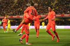 Neymar of FC Barcelona celebrates with Luis Suarez after scoring his team's opening goal during the Copa del Rey Semi-Final, Second Leg match between Villarreal CF and Barcelona at El Madrigal stadium on March 4, 2015 in Villarreal, Spain.