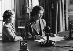 Princess Elizabeth of England (center), 14-year-old heiress apparent to the British throne, makes her broadcast debut, delivering a three-minute speech to British girls and boys evacuated overseas, on October 22, 1940, in London, England. She is joined in bidding good-night to her listeners by her sister, Princess Margaret Rose. (AP Photo)