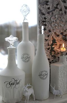 Simply painted wine and liquor bottles decorated up a bit...aren't they great?