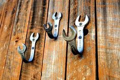 Old mismatched wrenches have a new job here as coat hooks.  Good idea.