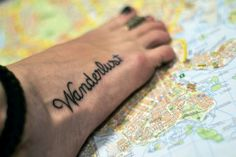 Wanderlust. I love this font. I think it's the only foot tattoo that I've actually liked.