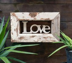 Rustic love sign mounted on recycled timber frame.  You won't see these anywhere else!!!!    Frame Measures 52cm x 32cm x 10cm. This type of timber is hard to find so I can't guarantee that we can make another one the same. ..... $95. Head to our website to order www.newagerusticdesigns.com.au
