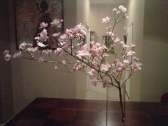 DIY cherry blossom centerpiece with a real branch and silk flowers.