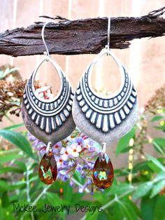 Silver tribal pendants, Bali sterling silver and crystal earrings. McKee Jewelry Designs