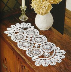 Long rectangular shaped free crochet doily pattern with two rows of small joined circles and a beautiful lace border all around. More Great Patterns Like This