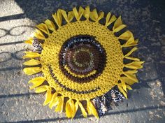 crocheted RAG RUG, sunflower ... For the porch. I wonder if I could do something like this with coloured garbage bags?