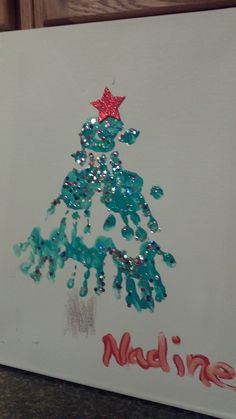 Handprint Christmas Tree on canvas, complete with sequins and a star sticker Great for grandparents