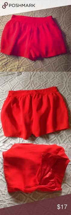 Flowy red shorts Beautiful red shorts that are not skin tight but have a nice flow at the bottom with a tight waist line. NOT Alice Olivia. From forever 21 Alice + Olivia Skirts Mini