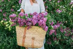 lilacs overflow a market backpack from Out of Hand in Mt. Pleasant and Terrrain.