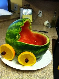 A watermelon bassinet! This is what the fruit salad is going in for my aunt's baby shower! I used a jack-o-lantern carving kit to help me with the details.