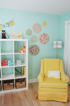 more pretty. Fabric circles, cube bookcase, yellow chair.