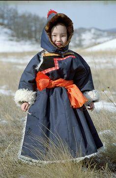Buryat Child Wearing Traditional Clothes, Buryatia, Lake Baikal. kind of traditional Mongolian costume