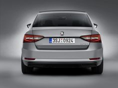 The wide 'C' is represented by a fine LED strip of light, which extends through both parts of the tail lights in the higher Style and L&K trim versions #newskodasuperb #skoda #superb