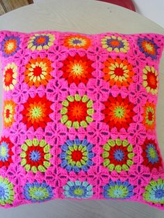 colourful crocheted cushion cover