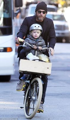 Safety first: Little Samuel held on tight to Liev's handle bars as the father and son peddled home