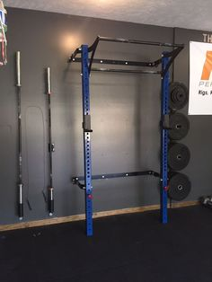 The 3x3 Profile Rack in blue with weight plate storage and single bar holders.