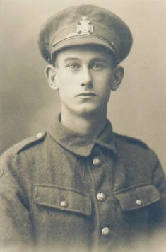 BEF - Soldier of the 16th London Regiment in Service Dress Jacket - Kitchener or Economy Pattern - 5 Front Buttons, Breast Pockets, buttoned, no pleats; and no Rifle Patches. Note there are no lapel badges. WW1.