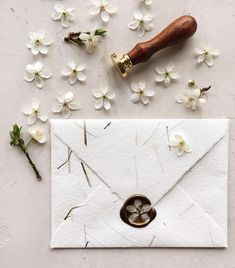 Handmade paper envelope and flower wax seal . - Koyal Wholesale Weddings - Handmade paper envelope and flower wax seal .