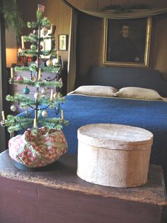 Love this colonial bedroom with the simple feather tree