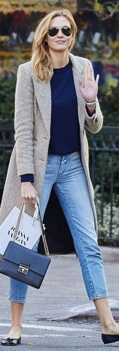 Karlie Kloss: Shoes – Chanel  Coat =- Smythe  Sunglasses – Ray  Purse – Dolce & Gabbana