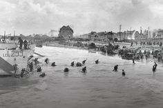 [Photo] Men of Canadian Infantry Brigade disembarking from LCI(L) landing craft onto Nan White Beach near Bernières-sur-Mer, Juno Beach, Normandy, France, late morning 6 Jun note many with bicycles. Photo 1 of Normandy Beach, D Day Normandy, Normandy France, D Day Beach, Juno Beach, Saint Aubin, Canadian Soldiers, Canadian Army, British Army