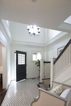Two Story Foyer Design Ideas, Pictures, Remodel, and Decor - Houzz - Meredith Heron Entrance Ways, House Entrance, Grand Entrance, Foyer Design, House Design, Tile Design, Foyer Flooring, Black Front Doors, Black Windows