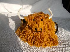 Flora the Highland Cow tea cosy is handknit and an original design from the…