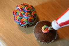 Rainbow frosting--use an icing bag with star tip.  Paint the 6 colors using paste food coloring and then fill the bag with white frosting.