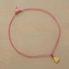 WISH UPON A HEART BRACELET - A wish made when donning this bracelet is said to come true once the Irish linen cord finally breaks. Exclusive. Handcrafted in USA with heart in sterling silver dipped in either 14kt rose or yellow gold or sterling silver