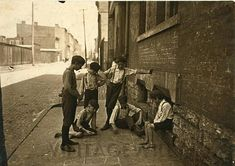 old photograph kid playing dice street art early